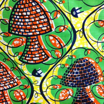 African Wax Print Fabric by the HALF YARD.  Mushrooms in green, orange, yellow and black.