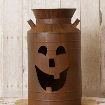 Rusty Milk Can with Jack-O'-Lantern Cut Out Face