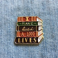 """I Have Lived A Thousand Lives"" Gold Book Stack Enamel Pin"