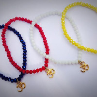 Pretty Crystal Bracelet with gold plated Aum Om Charm