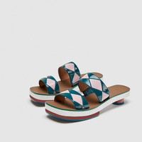 LEATHER SLIDES WITH GEOMETRIC DETAIL DETAILS