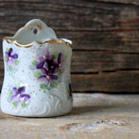 antique porcelain wall pocket with violets