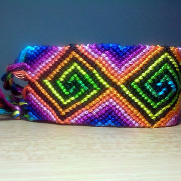 Psychedelic swirl in rainbow colors, macrame bracelet by KalisteBracelets on Etsy