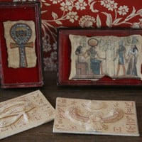 Dollhouse miniature case framed with ancient egyptian papyrus on red velvet