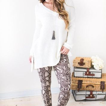 Bitten Heart Brown Snake Print Leggings
