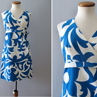 70s McInerny dress - 70s vintage blue white hawaiian resort novelty print wrap beach coverup mini sleeveless waist tie tiki muumuu cotton