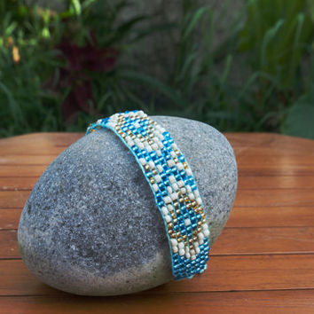 Loom beaded boho friendship bracelet in BLUE/GOLD with Bali traditional songket pattern