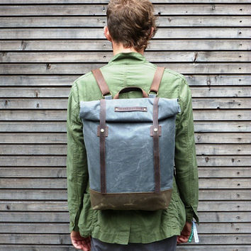 Waxed canvas rucksack/backpack with roll up top and waxed leather shoulderstrap