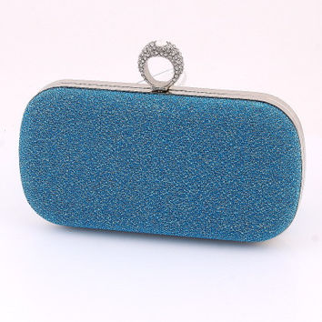 Blue Clutch with a Ring Handle