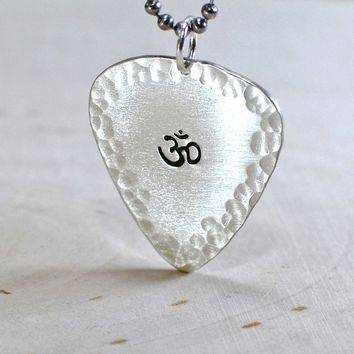 Sterling silver Om guitar pick pendant with hammered borders