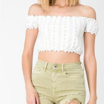 PISTACHIO HIGH RISE DISTRESSED SHORTS WITH UNFINISHED HEM