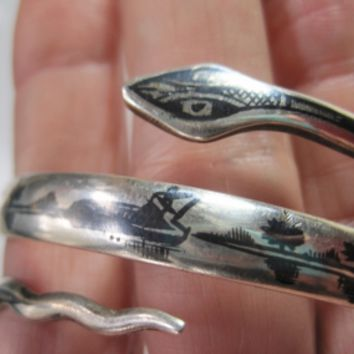 Vintage Middle East Silver and Niello Triple Coil Snake Bracelet from the 1940s