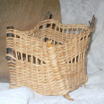 Decorative handmade wicker basket from paper and driftwood