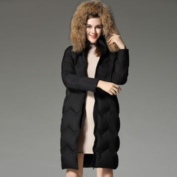 2016 autumn and winter outerwear women's medium-long down coat fashion raccoon fur thermal
