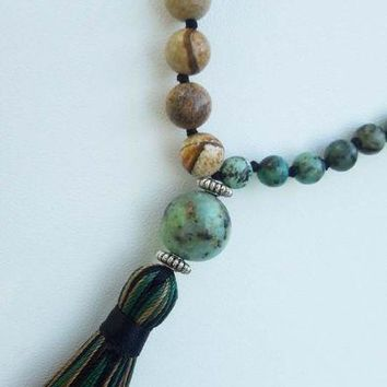 Mala Lava Stone And Tassel Necklace