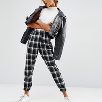 ASOS | ASOS Wrap Front Check Peg Pants at ASOS