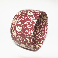 Stylish paper wrapped bangles by Funky Chunkies, Red bracelet with white leaves and scrolls,