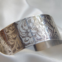 solid silver hinged bangle with 1940s inscription