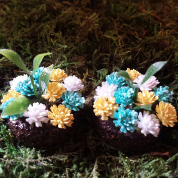 Fairy garden accessories. Set of 2  miniature round flower beds.  Turquoise, yellow, and white flowers.