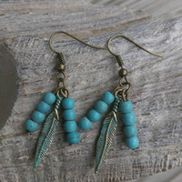 Turquoise dangle earrings. Patina feather western earrings. Bohimian earrings.