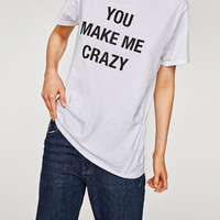 T-SHIRT WITH CONTRASTING SLOGANDETAILS