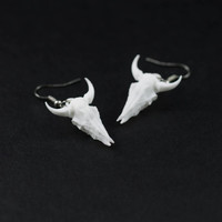 Small Bison Skull Earrings in White - A pair of white bison skull earrings on  silver tone hooks to adorn your head