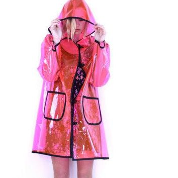 Pink Plastic P O P See Through Hooded Raincoat . Napkin